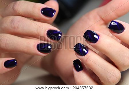 Beautiful manicure gel with cat lacquer eye