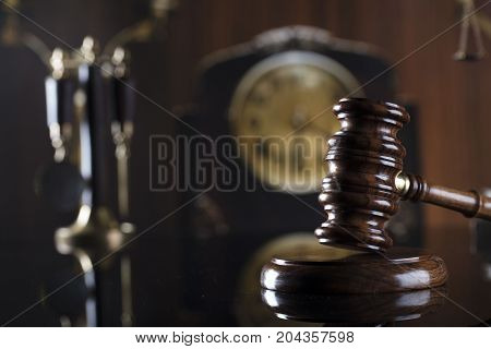Old court library. Vintage clock. Statue of justice and gavel. Law concept.