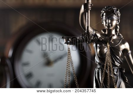 Old court library. Vintage clock and statue of justice. Law concept.
