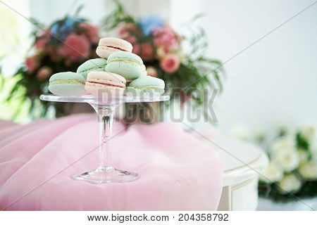 Gentle pastel colourful macaroons on pink and white soft background