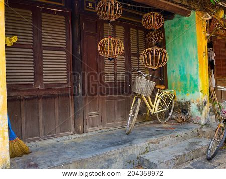 Hoian, Vietnam - August 20, 2017: Close up of a bike parked at backyard in the patio, in a house in Hoi An ancient town, in Vietnam.