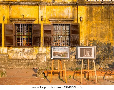 Hoian, Vietnam - August 05, 2017:Outdoor exposition of art, some beautiful pictures in front of old houses in Hoi An ancient town, UNESCO world heritage, in Vietnam.