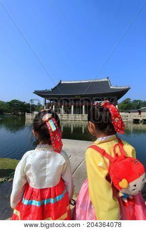 SEOUL SOUTH KOREA - SEPTEMBER 19: Gyeongbokgung Palace with Korean national dress Photo taken on september 19 2013 in Seoul South Korea