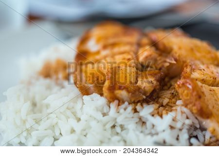 Barbecued Red Pork In Sauce With Rice And Cucumber