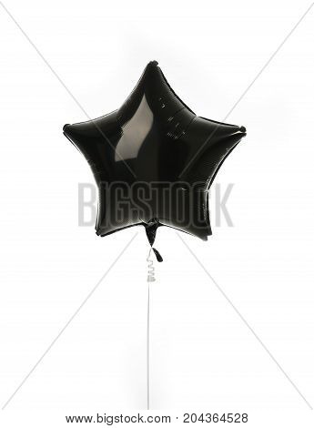 Single black big star metallic balloon object for birthday isolated on a white background