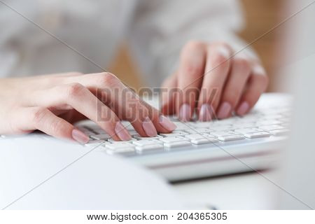 Female Hands Typing On Silver Keyboard Using Computer