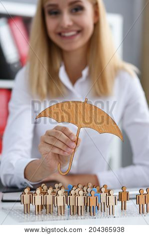 Smiling Business Woman In Hand Holds A Miniature Umbrella In The Hand