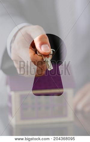 Man In Suit And Tie Hold In Hand Silver Key