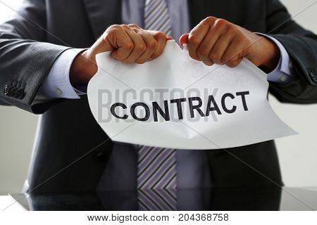 White Collar Worker In Suit And Tie Tear Contract