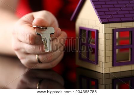 Male Hand Hold Silver Key Giving It To Buyer