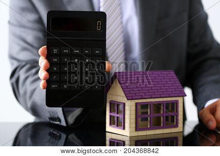 Man In Suit And Tie Hold In Arms Calculator