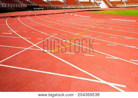 red running track line on athletic stadium