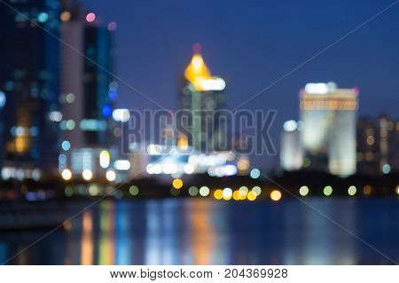 Night twilight blurred bokeh light city office building abstract background