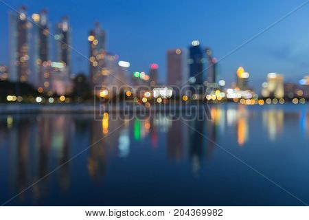 Blue twilight office building blurred boke light with reflection abstract background