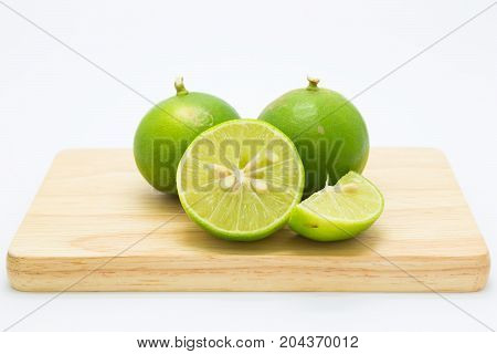 Fresh slide limes fruit on wooden board