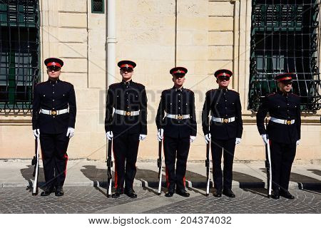 VALLETTA, MALTA - MARCH 30, 2017 - Uniformed soldiers on parade outside the Auberge de Castille for a European Union conference in Castille Square Valletta Malta Europe, March 30, 2017.