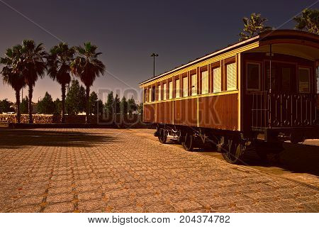 Retro wooden railway carriage at old station of Tel Aviv at sunset. Israel historic train on the line from Tel Aviv to Jerusalem