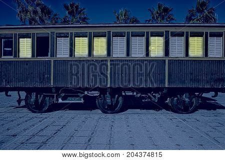 Retro wooden railway carriage at old station of Tel Aviv at night. Israel historic train on the line from Tel Aviv to Jerusalem