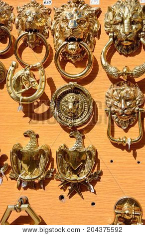 Brass door knockers for sale in the old town Mdina Malta Europe.