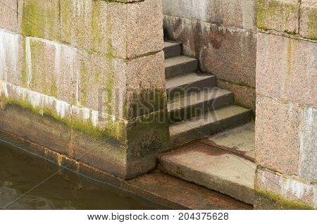 The embankment was faced with granite.Here there is a descent to the water.