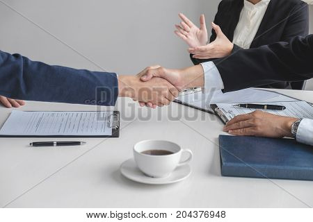 greeting new colleagues Handshake while job interviewing male candidate shaking hands with Interviewer or employer after a job interview employment and recruitment concept.