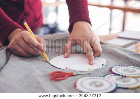 professional Fashion designer working of drawing sketches project for new trendy Fashion Style Design Concept in workplace.