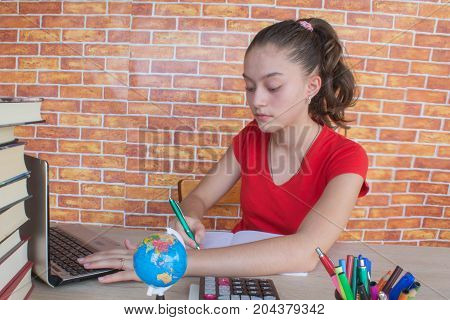 Student Young Girl working on his homework. Portrait of pretty girl high school student studying and writing. Thoughts education creativity concept