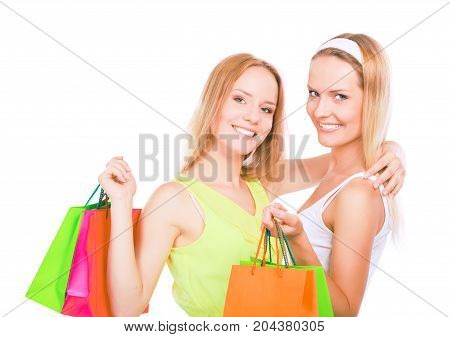 Two young women standing with shopping bag.