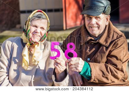 Happy elderly couple in love celebrating their anniversary. Love concept