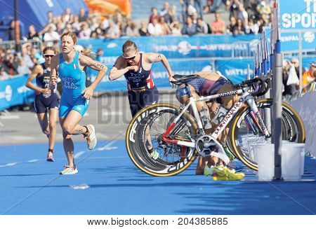 STOCKHOLM - AUG 26 2017: Female triathlete Betto and Stimpson change from cycle to run running in the transition zone in the Women's ITU World Triathlon series event August 26 2017 in Stockholm Sweden
