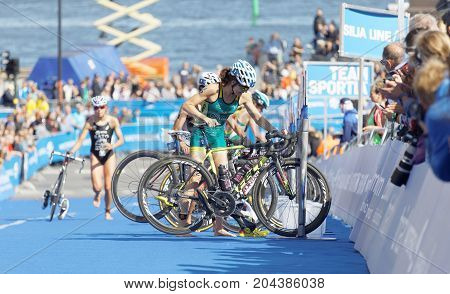 STOCKHOLM - AUG 26 2017: Female triathletes Ashleigh Gentle (AUS) and Andrea Hewitt (NZL) parking cycles in the transition zone in the Women's ITU World Triathlon series event August 26 2017 in Stockholm Sweden