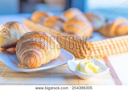 Tasty Croissants With Spikelets On Wooden Background; Taste Of France To The Breakfast Table.