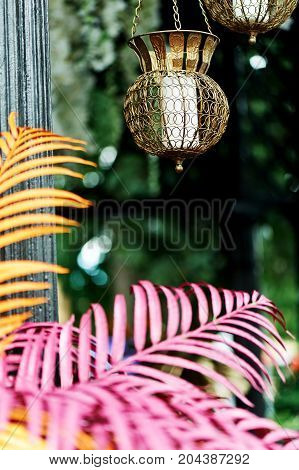 beautiful Indonesian carved candle holders with candles.Warm and beautiful, hanging in the air