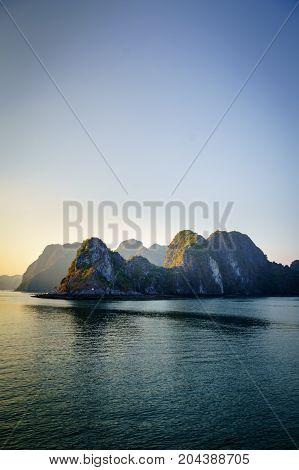 Halong bay sunset landscape with karst islands. Ha Long Bay is UNESCO World Heritage Site and popular tourist destination