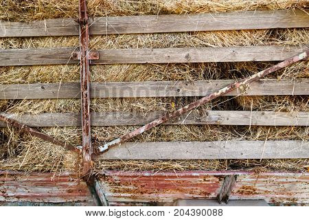 Close Up Of Rusty Old Flatbed Trailer Stacked Up With Hay.