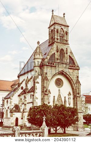 St. Michael chapel in Kosice Slovak republic. Architectural scene. Vertical composition. Yellow photo filter.