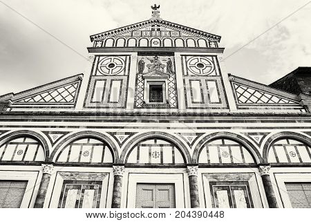 Basilica San Miniato al Monte standing atop one of the highest points in the city. Florence Tuscany Italy. Black and white photo.
