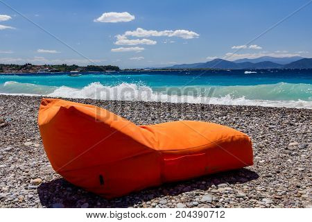 Luxury and comfortable mattress sunbed is placed on the sunny beach.