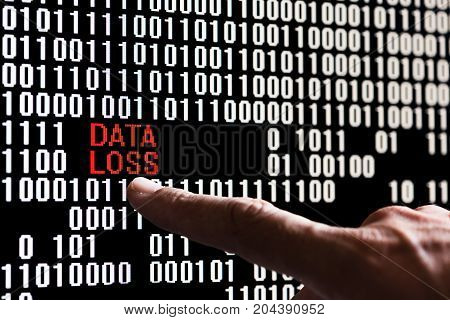 Finger pointing bank account data in binary code on a computer screen