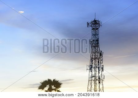 The silhouette scene of telecommunication tower with the twilight sky.