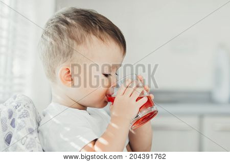 Two Years Boy Drinking Compote