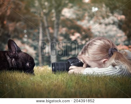Little girl photographing a dog. Little girl photographing a dog. Nature, Park, grass