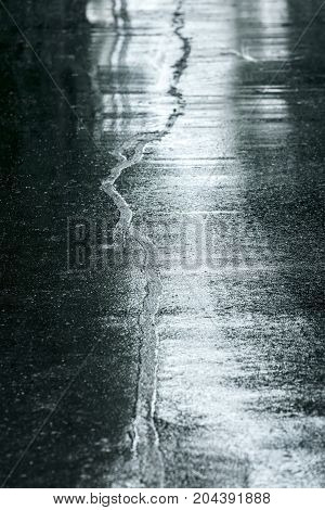 Wet Sidewalk In Rainy Day. Water Puddles On Street Road Surface.