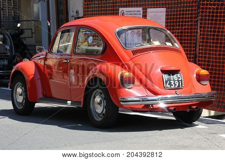 LASTRA A SIGNA, ITALY - AUGUST 30 2015: Vintage red beetle parked on the street in Lastra a Signa Florence
