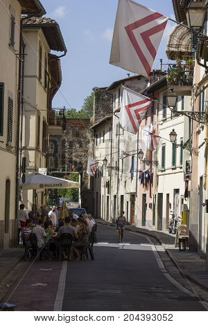 LASTRA A SIGNA, ITALY - AUGUST 30 2015: Narrow alley in the city centre of the municipality of Lastra a Signa historic town Tuscany