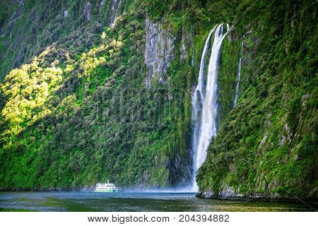 Scenic Cruise Approaches Waterfall, Milford Sound.