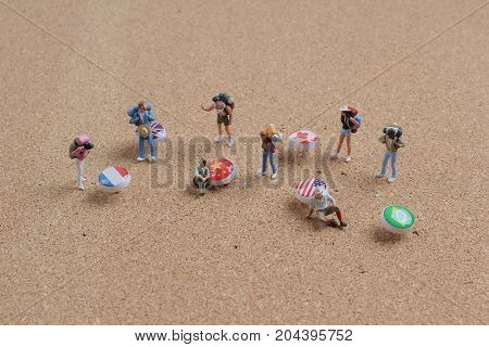 Figures With Backpack Standing On Pin