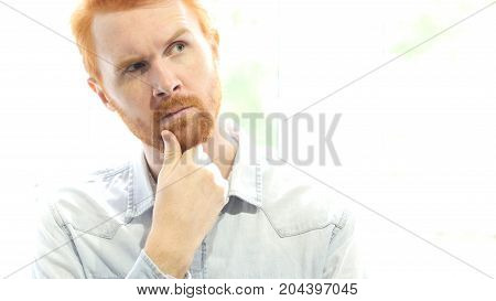 Positive Red Hair Beard Man Thinking  About New Startup Project