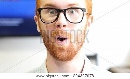 Happy News Surprising Young Man, Amazed Red Hair Beard Face Closeup