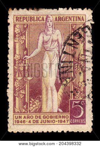 ARGENTINA - CIRCA 1947: a stamp printed in the Argentina shows allegorical figure of Justice, 1st Anniversary of the Peron Government, circa 1947